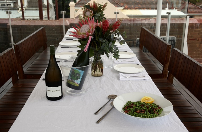 Sunday- Table with peas and wine